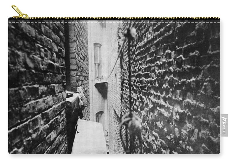 1890 Carry-all Pouch featuring the photograph New York: Tenement, C1890 by Granger