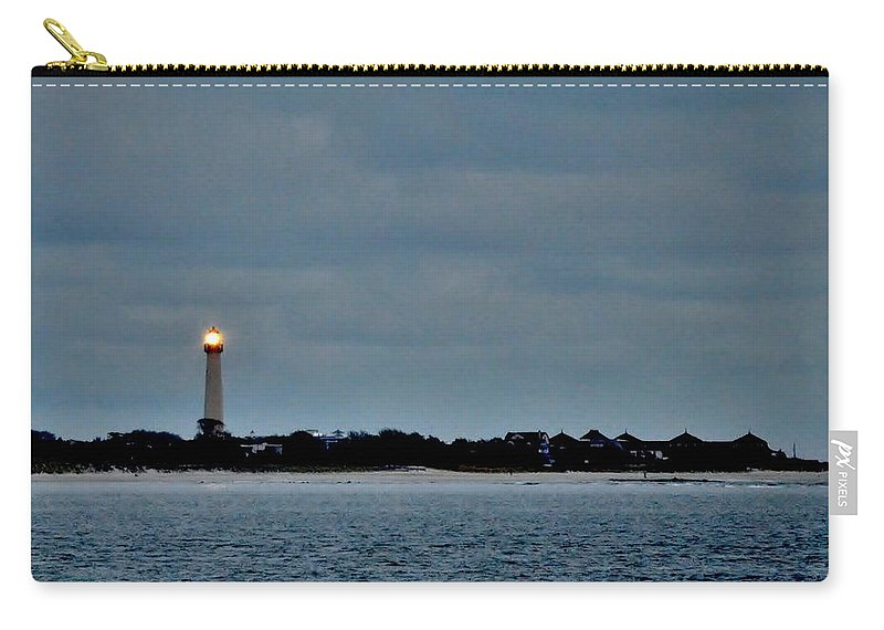 Lighthouse Carry-all Pouch featuring the photograph Night Beacon - Cape May Lighthouse by Kim Bemis