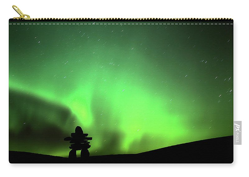 Inukchuk Carry-all Pouch featuring the digital art Northern Light Above An Inukchuk In Saskatchewan by Mark Duffy