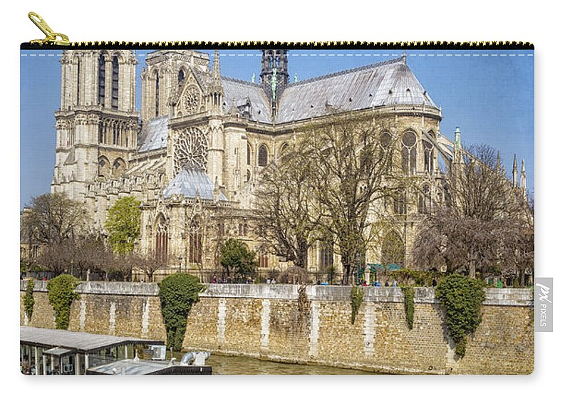Joan Carroll Carry-all Pouch featuring the photograph Notre Dame And The Seine by Joan Carroll