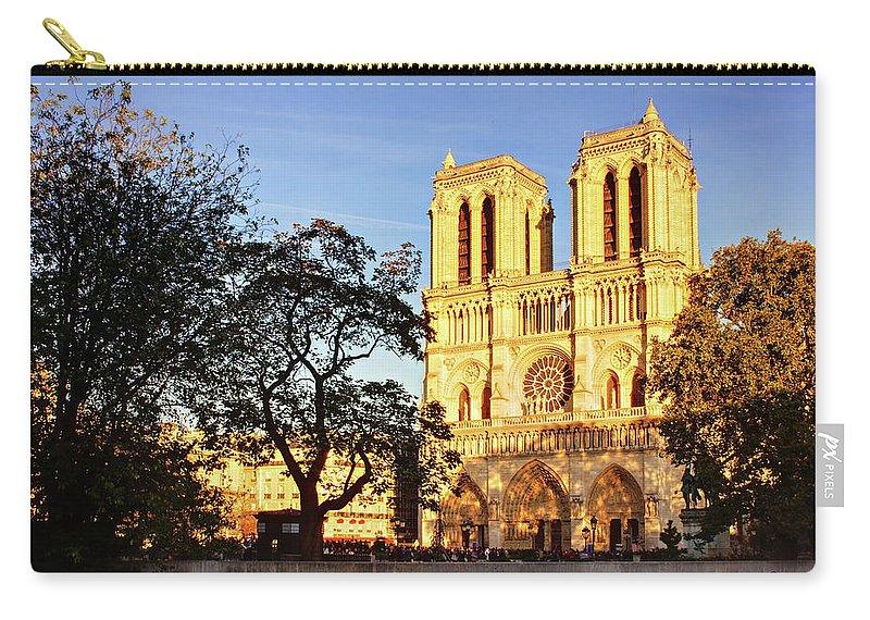 Paris Carry-all Pouch featuring the photograph Notre Dame De Paris Facade by Barry O Carroll