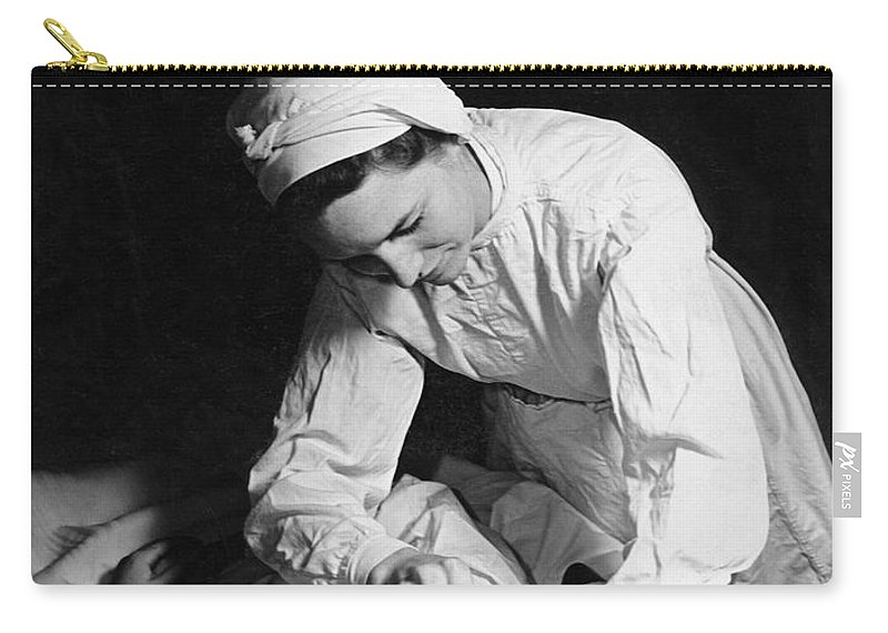 1930s Carry-all Pouch featuring the photograph Nurse Tending To A Patient by Underwood Archives