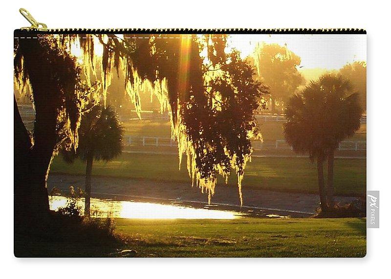 Sunset Carry-all Pouch featuring the photograph Ocala Sunset by Kristen Wesch