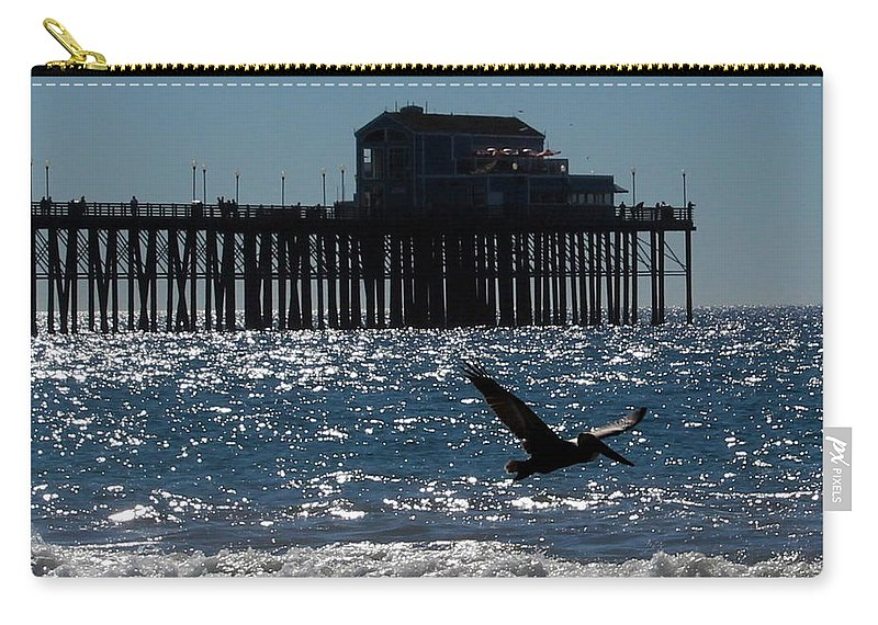Oceanside Carry-all Pouch featuring the photograph Oceanside Resident Photograph by Kimberly Walker