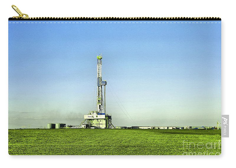 Oil Rig Carry-all Pouch featuring the photograph Oil Rig In North Dakota by Jeff Swan