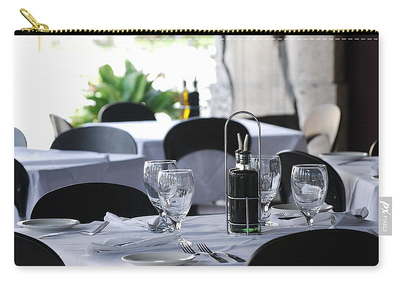 Tables Carry-all Pouch featuring the photograph Oils And Glass At Dinner by Rob Hans