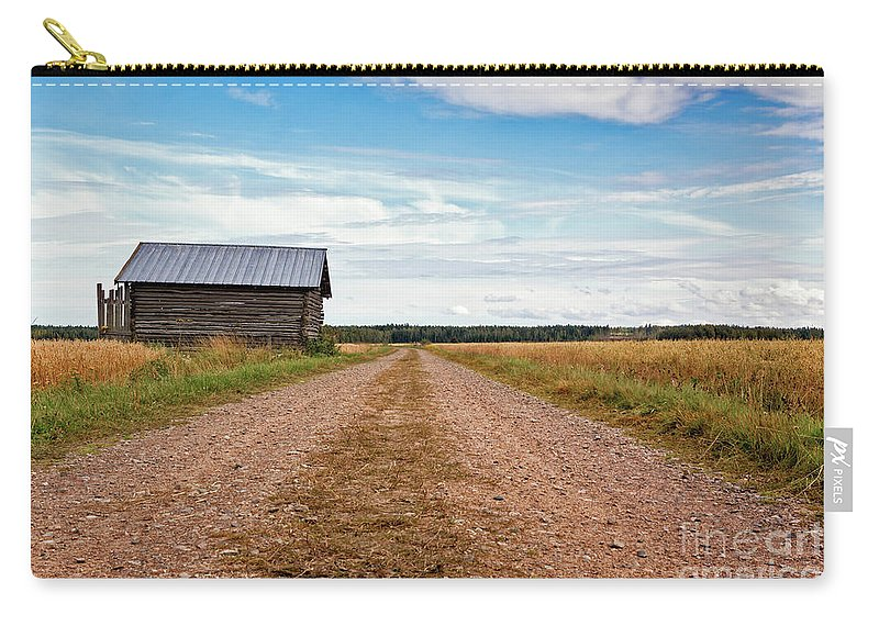 Copy Space Carry-all Pouch featuring the photograph Old Barn By The Gravel Road by Jukka Heinovirta