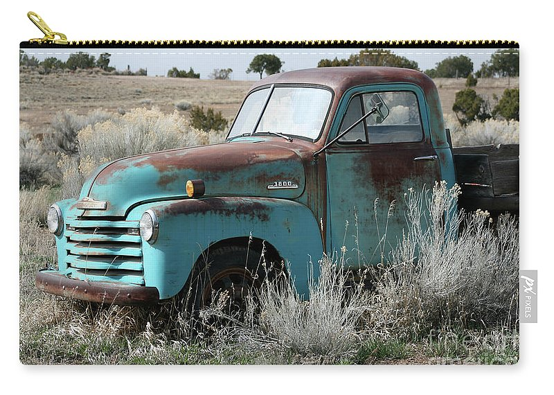 Antique Carry-all Pouch featuring the photograph Old Chevy Farm Truck In The Field by CheyAnne Sexton