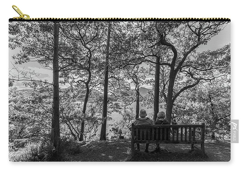 Cumbria Lake District Carry-all Pouch featuring the photograph Old Couple On The Bench By The Lake by Iordanis Pallikaras