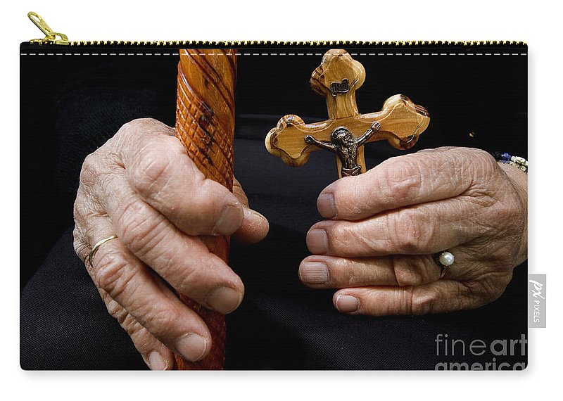 Old Carry-all Pouch featuring the photograph Old Hands And Crucifix by Danny Yanai