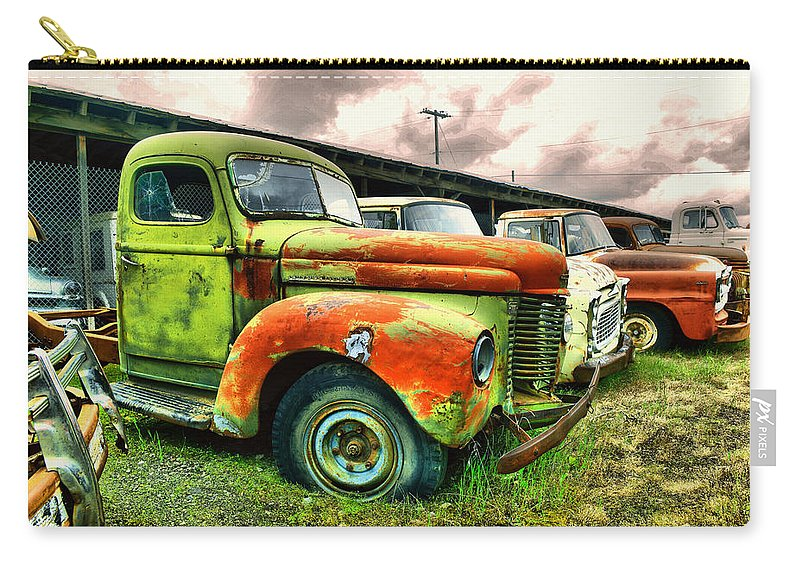 Relics Carry-all Pouch featuring the photograph Old Trucks In A Row by Jeff Swan