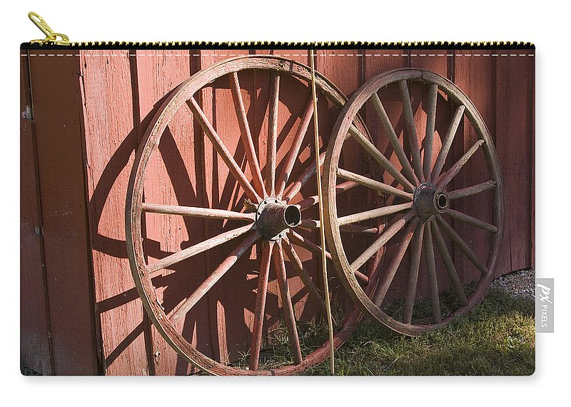 Old Time Antique Wagon Wheel Wood Wooden Red Barn Rural Country Farm Farming Round Carry-all Pouch featuring the photograph Old Wagon Wheels by Andrei Shliakhau