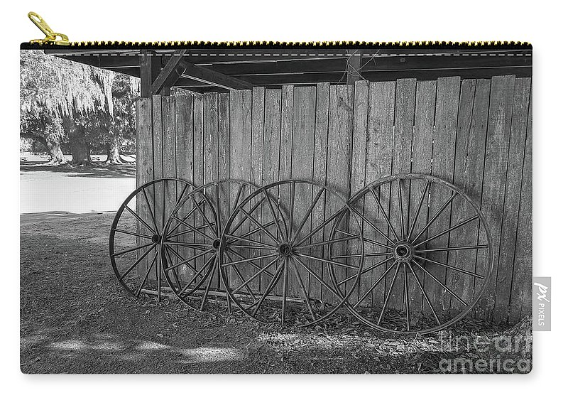Black And White Carry-all Pouch featuring the photograph Old Wagon Wheels Black And White by Kathy Baccari