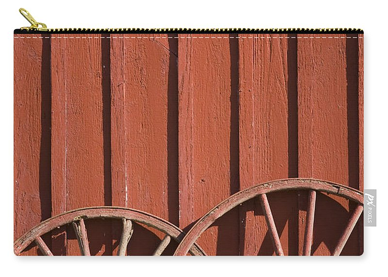 Wheel Wheels Wagon Old Red Barn Antique Past History Rural Country Carry-all Pouch featuring the photograph Old Wagon Wheels IIi by Andrei Shliakhau