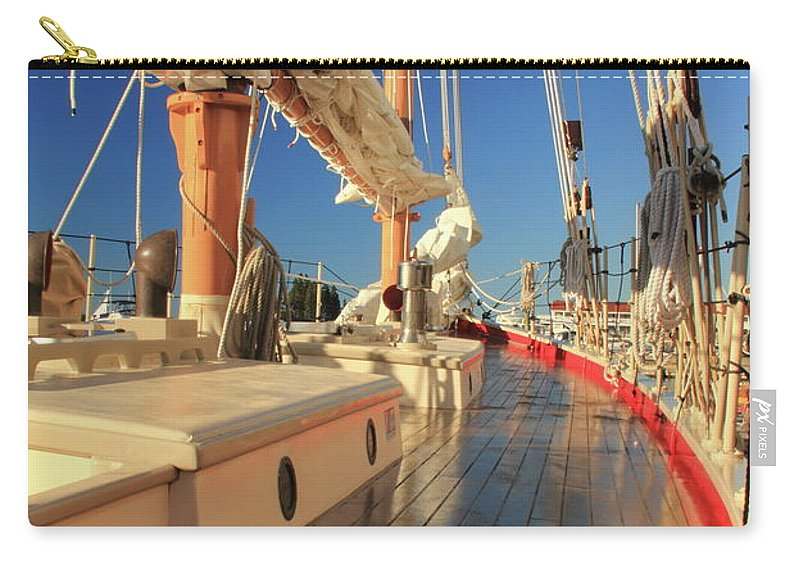 On Deck Carry-all Pouch featuring the photograph On Deck Of The Schooner Eastwind by Roupen Baker