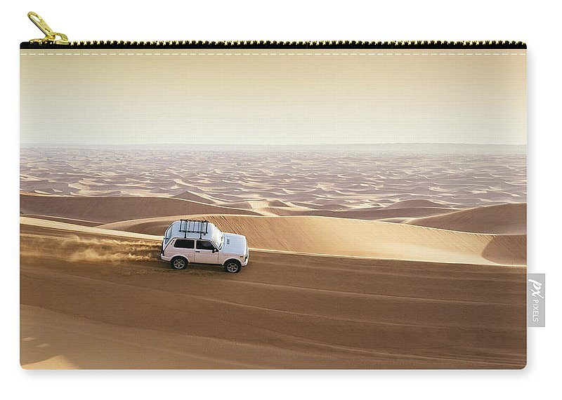 4x4 Carry-all Pouch featuring the photograph One 4x4 Vehicle Off-roading In The Red Sand Dunes Of Dubai Emirates, United Arab Emirates by Alexandre Rotenberg