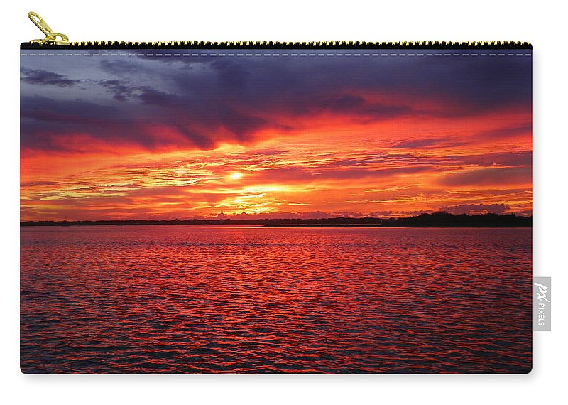 Sunsets Carry-all Pouch featuring the photograph Orange Burst At Daybreak by Karen Wiles