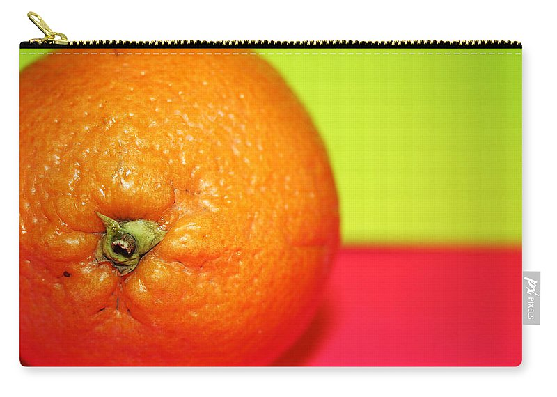 Oranges Carry-all Pouch featuring the photograph Orange by Linda Sannuti