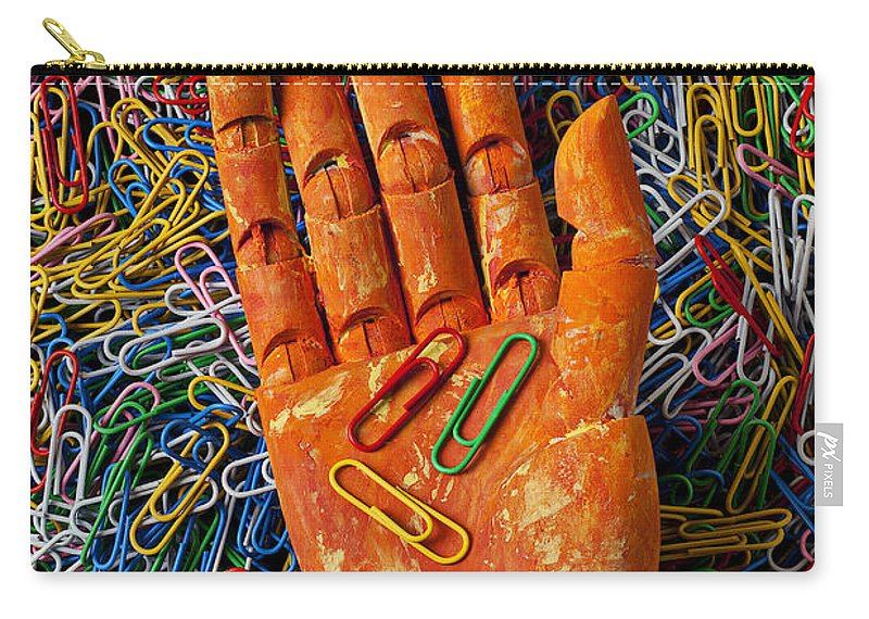 Orange Carry-all Pouch featuring the photograph Orange Wooden Hand Holding Paperclips by Garry Gay