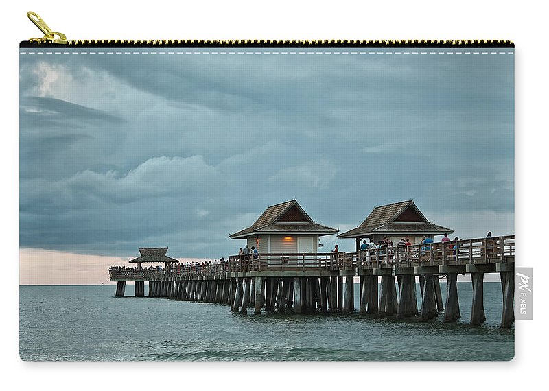 Naples Pier Carry-all Pouch featuring the photograph Clouds Over The Naples Pier by Jorge Crespo