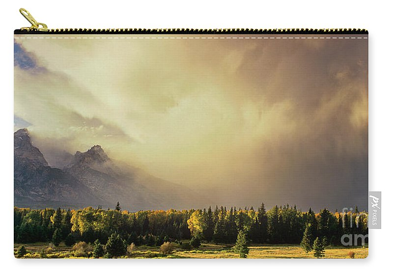 North America Carry-all Pouch featuring the photograph Panorama Clearing Storm Over The Grand Tetons by Dave Welling