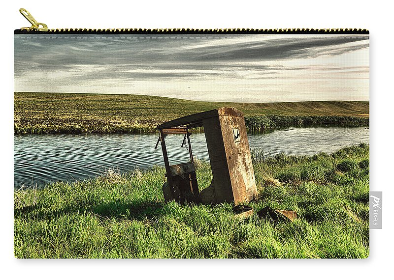 Remains Carry-all Pouch featuring the photograph Parked By The Pond by Jeff Swan