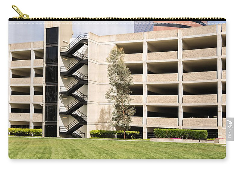 Buildings Carry-all Pouch featuring the photograph Parking Garage by Robert VanDerWal