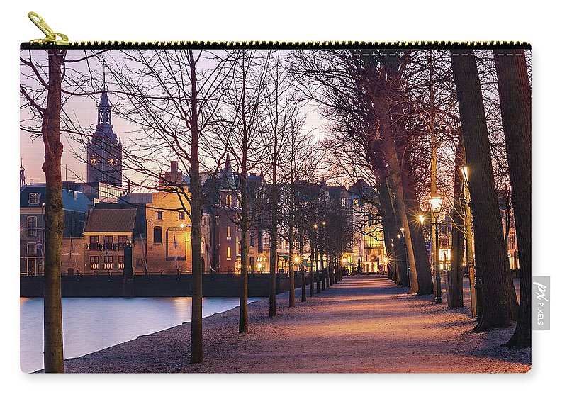 The Hague Carry-all Pouch featuring the photograph Path By A Pond - The Hague by Barry O Carroll