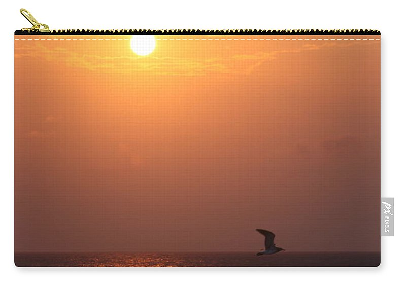 Birds Carry-all Pouch featuring the photograph Peach Sunrise And Bird In Flight by Nadine Rippelmeyer