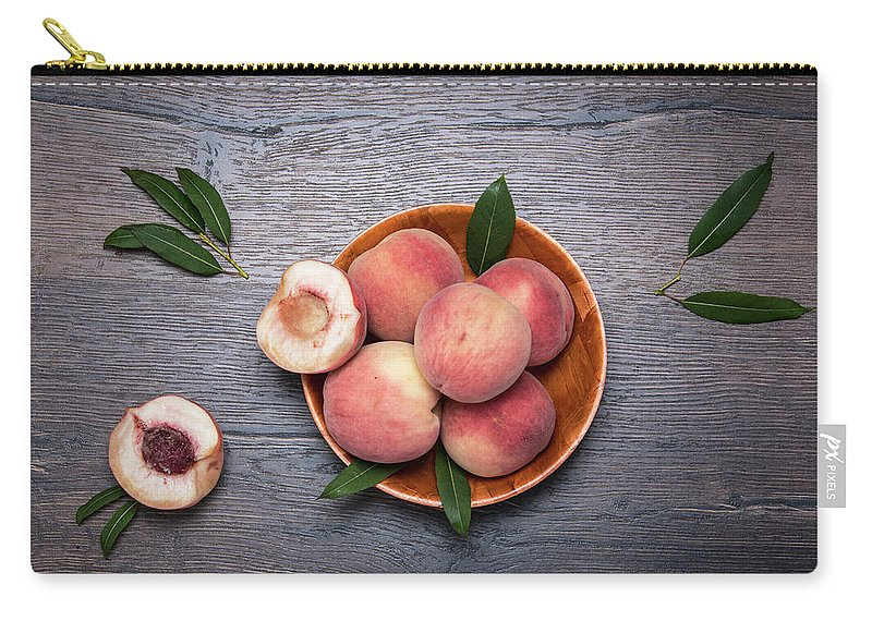 Peaches Carry-all Pouch featuring the photograph Peaches On A Dark Wooden Background by Sergei Dolgov