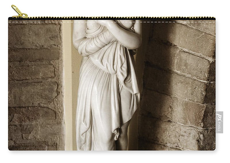 Statue Carry-all Pouch featuring the photograph Peering Woman by Marilyn Hunt