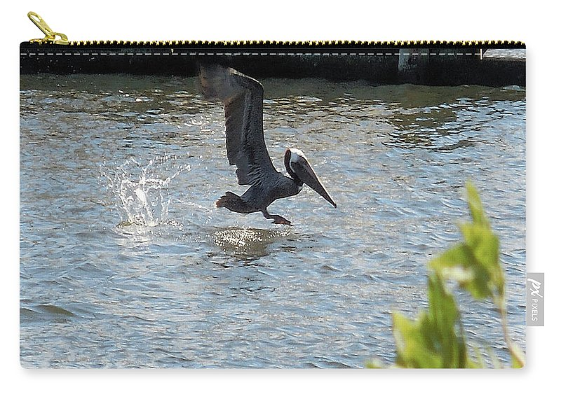 Pelican Carry-all Pouch featuring the photograph Pelican On The Waves by Roseann Stachowiak