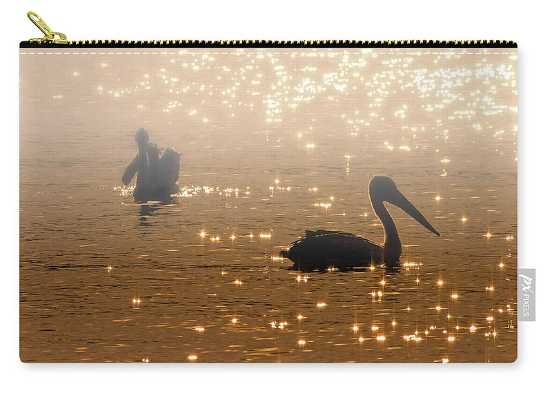 Pelican Carry-all Pouch featuring the photograph Pelican Sunrise by Mike Dawson