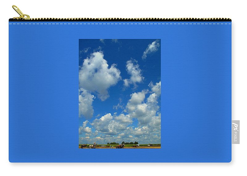 Clouds Carry-all Pouch featuring the photograph Ploughing Under A Mid Day Sun by Ian MacDonald