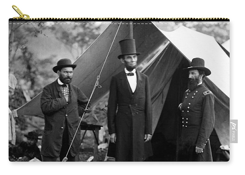 abraham Lincoln Carry-all Pouch featuring the photograph President Lincoln Meets With Generals After Victory At Antietam by International Images