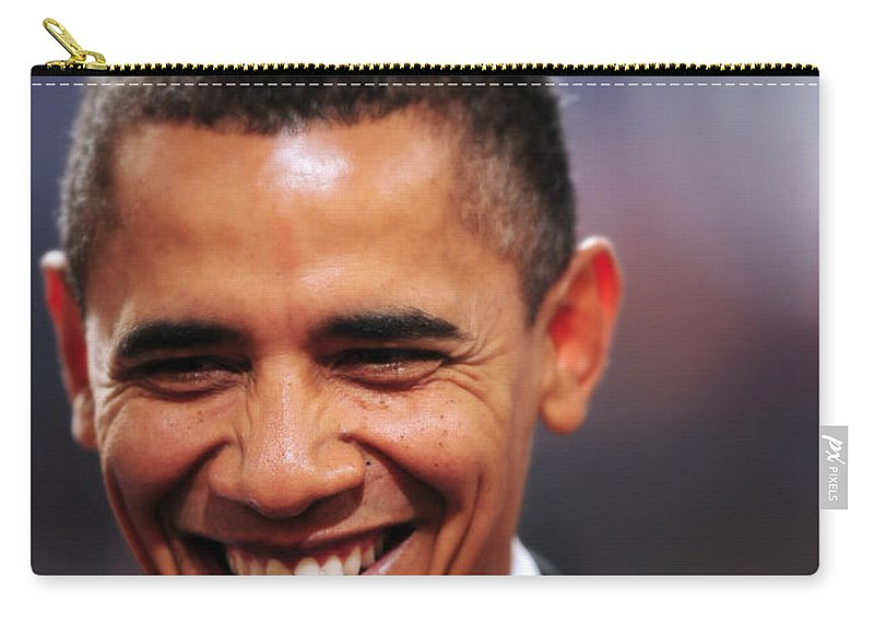 Obama Carry-all Pouch featuring the photograph President Obama IIi by Rafa Rivas
