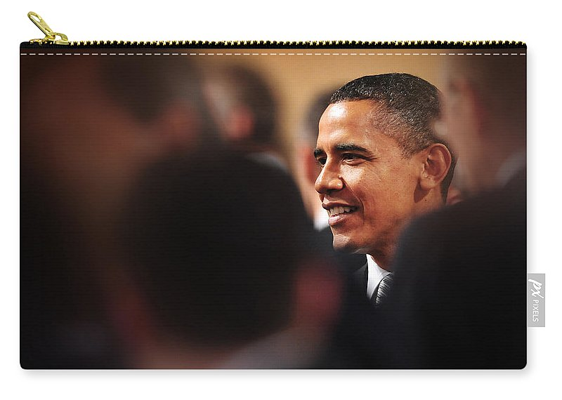 Obama Carry-all Pouch featuring the photograph President Obama by Rafa Rivas