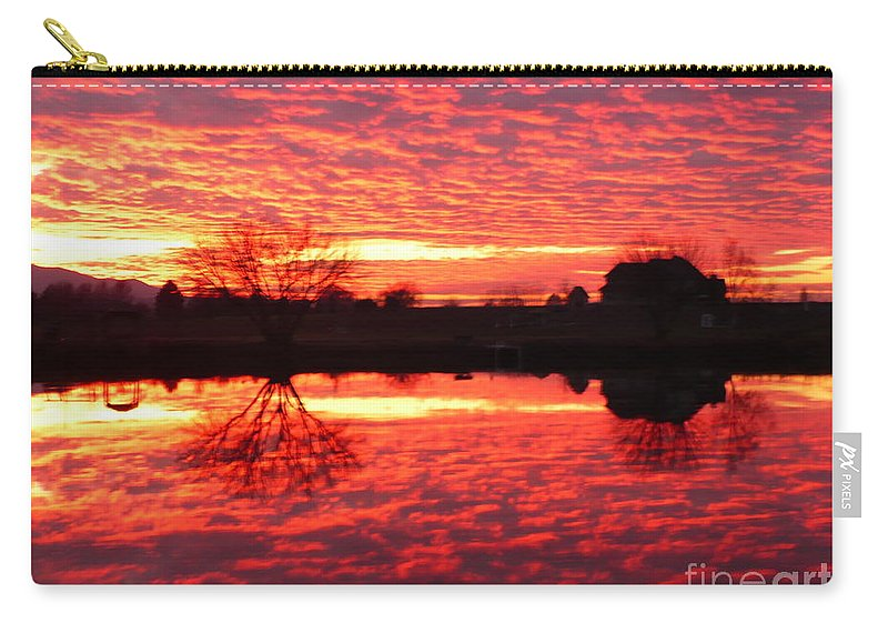 Orange Carry-all Pouch featuring the photograph Dramatic Orange Sunset by Carol Groenen