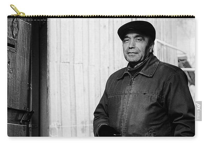 Monochrome Carry-all Pouch featuring the photograph Proud Handsome Man And House Door by John Williams