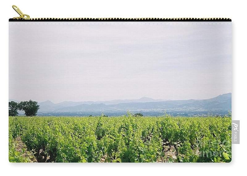 France Carry-all Pouch featuring the photograph Provence Spring Vineyard by Nadine Rippelmeyer
