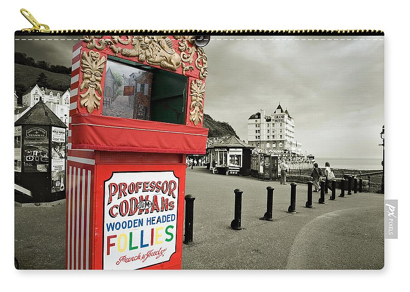 Punch And Judy Carry-all Pouch featuring the photograph Punch And Judy Theatre On Llandudno Promenade by Mal Bray