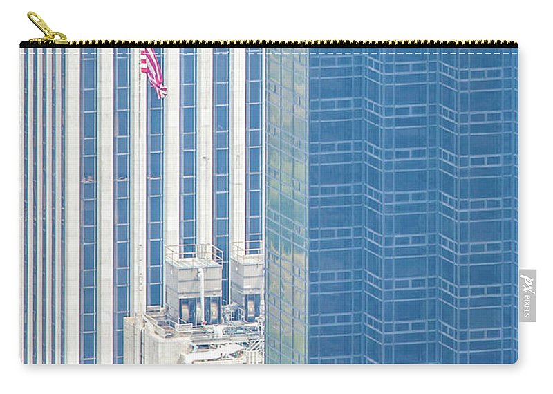 Architecture Carry-all Pouch featuring the photograph Raising The Flag by Az Jackson