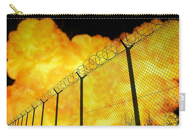 Prison Carry-all Pouch featuring the photograph Realistic Orange Fire Explosion Behind Restricted Area Barbed Wire Fence, Blurred Background by Lukasz Szczepanski