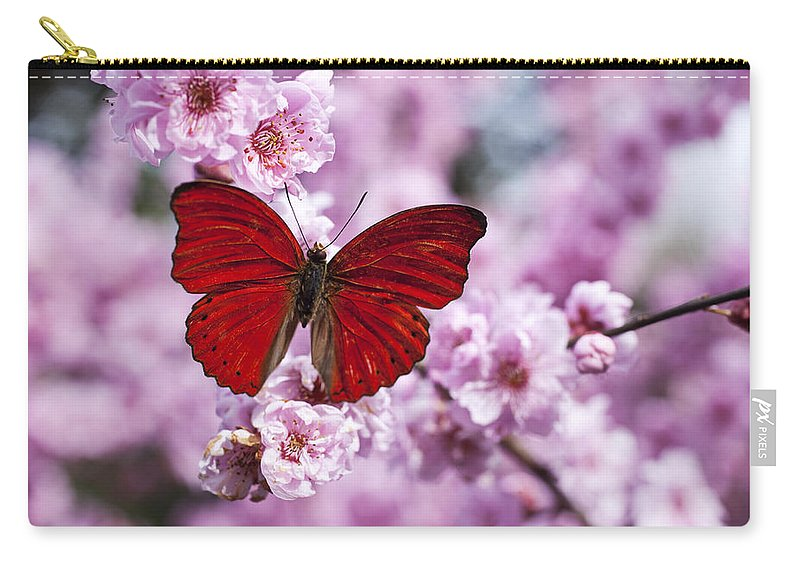 Red Carry-all Pouch featuring the photograph Red butterfly on plum blossom branch by Garry Gay
