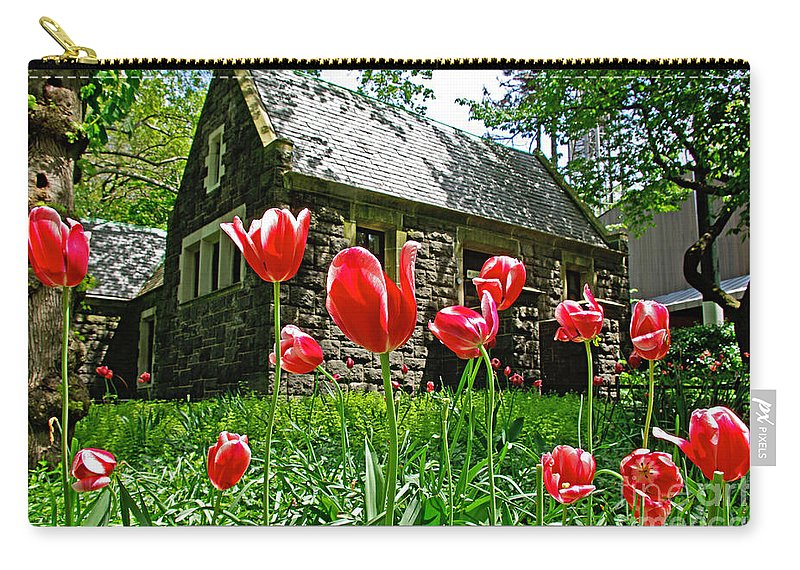 Red Carry-all Pouch featuring the photograph Red Flowers In Central Park by Zal Latzkovich