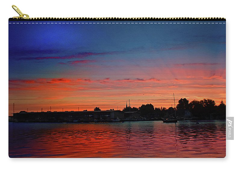Red Carry-all Pouch featuring the photograph Red Morning Sun by Joseph F Safin