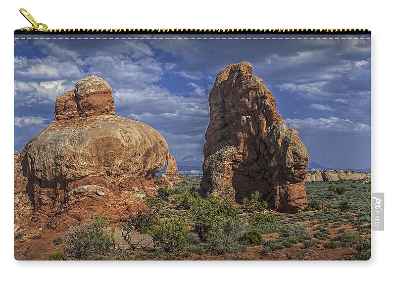 Rock Carry-all Pouch featuring the photograph Red Rock Formations On A Desert Plateau In Utah by Randall Nyhof