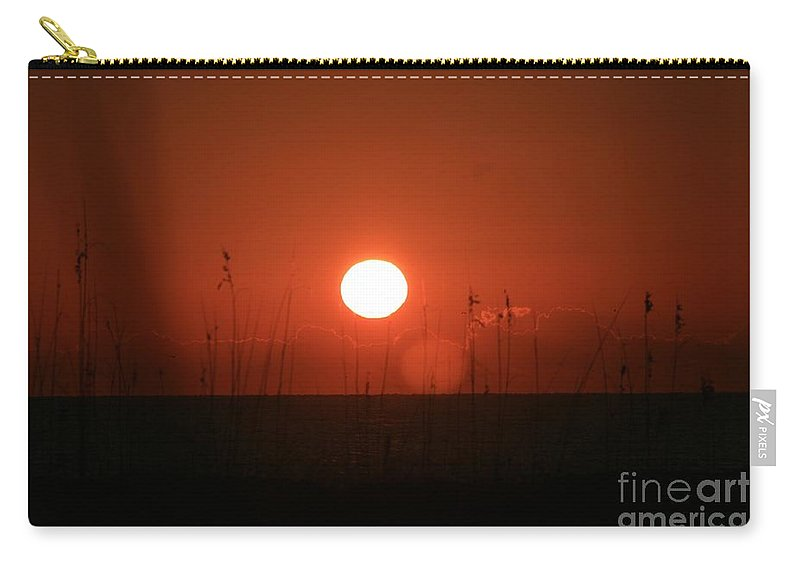 Sunset Carry-all Pouch featuring the photograph Red Sunset And Grasses by Nadine Rippelmeyer