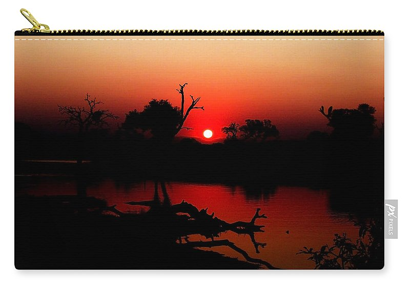 Adventure Carry-all Pouch featuring the photograph Red Sunset by Robyn R Hazen