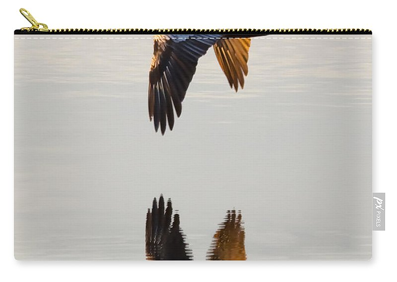 Pelican Carry-all Pouch featuring the photograph Reflecting Flight by Janet Fikar
